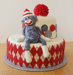 This was the cake at my sil's baby shower. It pays to have awesomely talented friends! Sock Monkey Cake | SugarHero.com