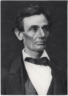 "'""Beardless Lincoln."" A black and white photograph of Lincoln, beardless, taken by Alexander Hessler on June 3, 1860, in Springfield, Illinois. The reverse includes a story about Grace Bedell convincing Lincoln to grow a beard for his upcoming election."