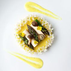 Organic roasted garlic asparagus, lightly pickled heart of palm, roasted beech mushrooms with coconut aminos, hooker's onion flowers, vegan hollandaise sauce, and egg.