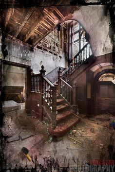 Entrance hall and stairs in an abandoned house  COPYRIGHT:© Viveca Koh 2012. All Rights Reserved