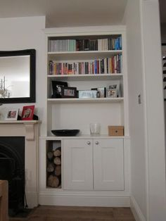 Alcove units with logs Alcove Storage Living Room, Living Room Units, Navy Living Rooms, Room Shelves, Alcove Cupboards, Built In Cupboards, Armoire, Small Space Bathroom, Lounge Design