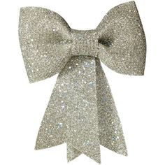 Add a shimmery touch to your holiday tree with this lovely ornament, showcasing a glittery bow design. Product: Bow ornament...