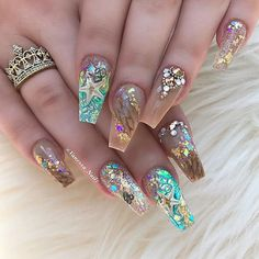 This is a lot of nail bling... but I like it! Maybe just on the accent nail...