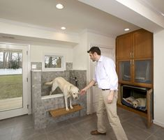 "Dog owners pull out all the stops to create canine spaces | S.J. Janis custom-built a 3-by-5-foot raised dog-washing station with a one-piece  base made of Vikrell, a nonporous composite material. ""It's low-maintenance and has no grout to clean,"" says director of sales Nathan Wachtl."