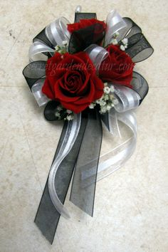 For the Mom's.  Pin on corsages with shear white and black ribbon.  Pretty little red spray roses, with touches of baby's breath.