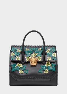 The Edera Palazzo Empire bag is a dual-carry style handbag from the Palazzo line featuring two top handles, removable shoulder strap, gold vintage tone metal Medusa Head clasp and hand-sewn painted leather leaves. This Limited Edition bag is a unique piece handcrafted by the finest Italian leather workers. A gold metal plate displays the bag's number out of 110 styles made in the world. A celebration of Gianni Versace's iconic legacy, inspired by his Spring Summer 1997 collection, it ...