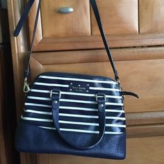 Kate Spade GROVE COURT STRIPE MAISE Fantastic crossbody great for the upcoming spring season! Adjustable strap. Worn but in great condition. There is a very small red dot in the back of the bag. That is the only flaw. Not noticeable when wearing. Dimensions from the website are: 9h x 10.5w x 4.9d kate spade Bags Crossbody Bags