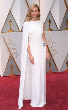Karlie Kloss from Oscars 2017: Best Dressed Women  The supermodel's ethereal Stella McCartney dress is perfectwith that thick choker—it's giving the illusion of a high neck where there isn't one and it works.