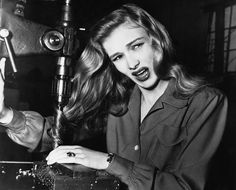World War II: Women at War - American film actress Veronica Lake, illustrates what can happen to women war workers who wear their hair long while working at their benches, in a factory somewhere in America, on November 9, 1943.  Women wanted to wear their hair in the elegant 'waterfall style' like Veronica.  Veronica's public safety message - and ultimately, her hair cut - inspired women workers to follow in her footsteps.