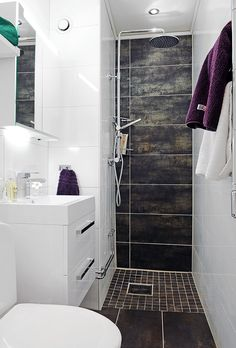 Small strip ensuite, having the floor tiles go up the skinny wall in the shower creates depth and interest
