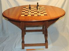Cherry wood table Chess squares of maple and cocobolo woods Drawer with brass pull handle With or without butterfly drop sides Table Top 39x 25 Table Height 25 Any custom made item will be similar to pictured, but not exactly as pictured Custom made items require extra time, approximately 8 - 10 weeks Chess or Checker Pieces NOT INCLUDED Pictured item has been sold, taking custom orders only