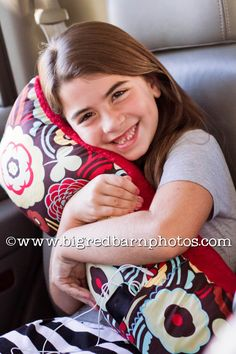 "Seatbelt Pillow - measures 28"" x 8"" and includes two seat belt straps and a 5.5"" front pocket"