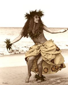 Himani  photograph  only in Hawaii did I see hula dancers practicing in the park with huge men beating the rhythm on tall drums