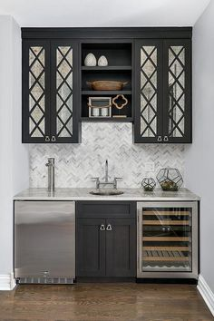 How nice would this be for holiday entertaining? Kegerator perfectly classy paired with antique mirror cabinets right? Oh and some marble. Mirror Backsplash, Mirror Cabinets, Black Cabinets, Pantry Cabinets, Antique Cabinets, Home Wet Bar, Bars For Home, Marble Herringbone Tile, Kitchen Designs Photos