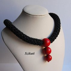 Beautiful one-of-a-kind statement necklace with an absolute unique, eye-catching shape and design.  Its a wonderful combination of red and black.