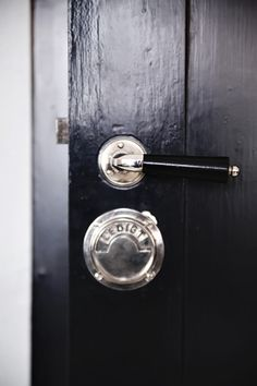 Chrome and black hardware on black door Door Knobs And Knockers, Knobs And Handles, Knobs And Pulls, Door Handles, Drawer Pulls, Modern Hepburn, Door Detail, Bathroom Doors, Bathrooms