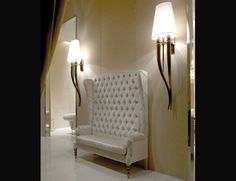 Italian made chair  by Siegfrid, shown here upholstered in white with capitonne back, embroidered sides and gold lacquered legs (also available with bronze lacquered legs). This furniture collection combines a modern look at form and function. Available in wide selection of fabrics and leathers (samples available upon request).
