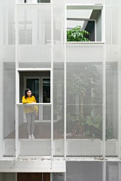 KC Design Studio has updated a 3.7-metre-wide house in Taiwan with a perforated facade and light-well to combat poor daylighting