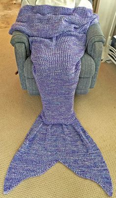 The crochet mermaid tail blanket by Lapghan is the most comfortable blanket you will ever snuggle into.