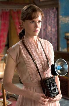 """Today's über-cool, über-beautiful celebrity with an über-cool camera:  NICOLE KIDMAN (as photographer Diane Arbus in the movie """"Fur"""") #camera #fun #smile #lens #cheese"""