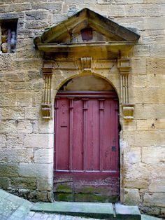 Stone building, puce door