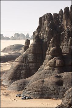 The Hoggar Mountains, also known as the Ahaggar, are a highland region in central Sahara, or southern Algeria, along the Tropic of Cancer. They are located about 1,500 km south of the capital, Algiers and just west of Tamanghasset.