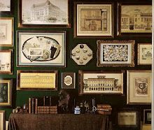 Art gallery wall by Mario Buatta. Maps, architectural drawings,engravings...