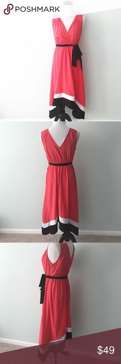 "Motherhood Maternity Coral Dress sleeveless Coral dress with black and white trim on bottom. Black tie belt. V-neck. Small spot towards bottom in pleat. Chest 17.5"". Length 39.5"" Motherhood Maternity Dresses Midi"