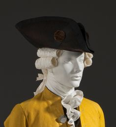 tricorn: flat hats with brim turned up at three points to form a triangle