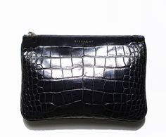 Givenchy blue crocodile clutch from Garance Dore article on Giorgia's style.