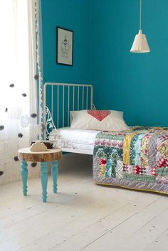 turqoise wall and wonderful quilt!!  Great color combo.