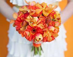 Orange bridal bouquet with mokara orchids, gerbera daisies, roses and calla lilies. #tangerine tango #cactus flower