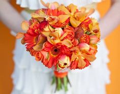 Orange bridal bouquet with mokara orchids, gerbera daisies, roses and calla lilies. #tangerine tango #cactus flower
