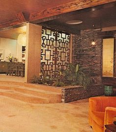 1970's Architectural Digest  Love the metal room divider & the brick!