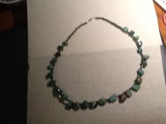 Green turquoise and iridescent green glass beads strung on mm beading wire, silver plated crimps and barrel clasp. Beaded Necklace, Beaded Bracelets, Green Turquoise, Iridescent, Barrel, Beading, Glass Beads, Wire, Silver