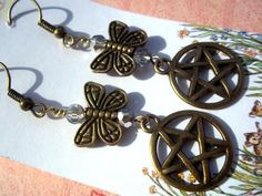 Pentacle and Butterfly Earrings Pagan Wiccan Jewelry: Pagan / Wiccan jewelry.  Bronze pentacles hang under bronze butterflies and sparkly clear half silver crystals. These have antique gold fish hook ear wires. Length is 1 1/2 inches not including the hooks....