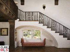 Cozy little reading nook. Arch, windows, bench, railing. And it's Reese Witherspoon's Ojai home.