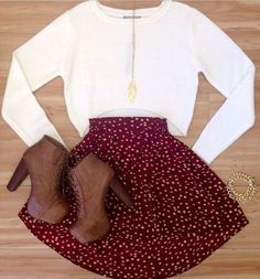White cropped sweater, a redish circle skirt, and brown laced up calf boots...good for the fall time