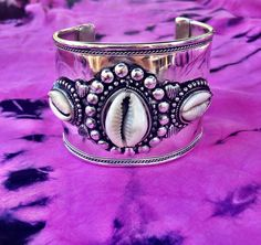 Silver cowrie shell cuff handmade by Indian artisans one size adjustable