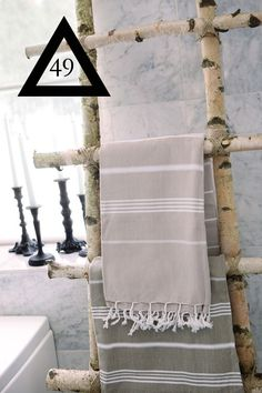 a rack for towels or magazines using tree branches