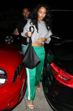 Only Rihanna could make sweatpants look this good—she paired the track bottoms with a crop top and delicate sandals for a night out. It may seem like an unusual combo, but the singer managed to keep the sporty-meets-dressy vibe going by not distracting from the bright green pants.