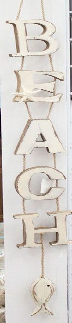 """BEACH"" vertical hanging wood sign"