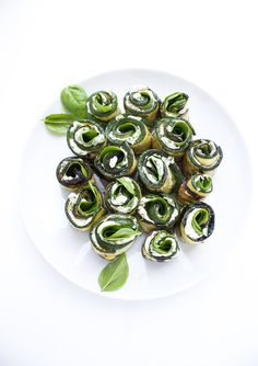 Grilled zucchini filled with herb cream cheese, baby spinach, and aromatic basil. Serve as an appetizer or side dish.