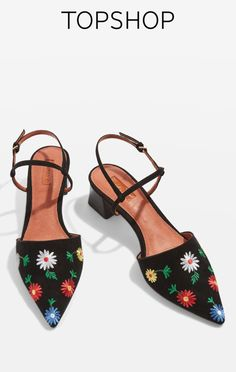 Black shoes with multi-coloured embroidery.