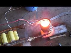 Plans at http://inductionheatertutorial.com This is a 3kw induction heater melting zinc.