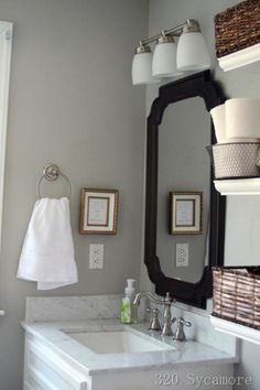 Gray walls for the bathroom. I love the mirror and I think this color could work with the dark brown accents in your bathroom. Gray Bathroom Walls, Bathroom Paint Colors, White Vanity Bathroom, Wall Paint Colors, Master Bathroom, Small Bathroom, Bathroom Shelves, Mirror Bathroom, Downstairs Bathroom