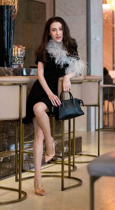 Fashion Blogger Veronika Lipar of Brunette from Wall Street sharing accessories to wear with little black dress with feathers for dinner date #partystyle #classic #classy