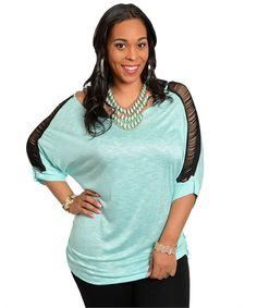 This slub knit quarter sleeve top features a scoop neckline with contrast fringe shoulder panel. Loose fitting with back center seams.