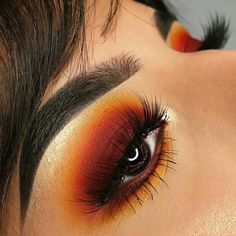 Absolutely gorgeous orange red eye makeup look