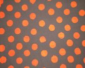 orange dots on gray. would look really cool with a contrasting color accent like lime green or a medium purple shade